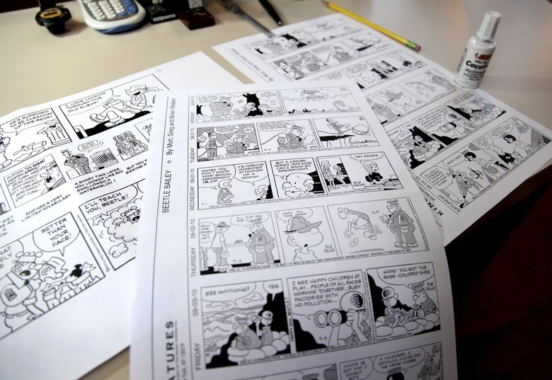 Beetle Bailey comic strips that will be published in the coming weeks rest on a desk in the studio of creator Mort Walker in Stamford, Conn., in 2010. (Craig Ruttle / The Associated Press)