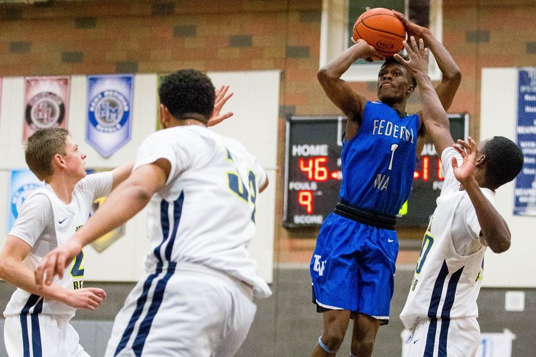 Marcus Austin (1) of Federal Way takes a three-point shot during the second half. (Courtney Pedroza/The Seattle Times)