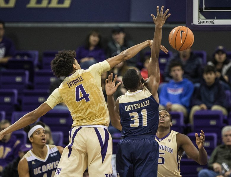 Matisse Thybulle gets all ball on this block of a shot by UC Davis' Michael Onyebalu. (Dean Rutz / The Seattle Times)