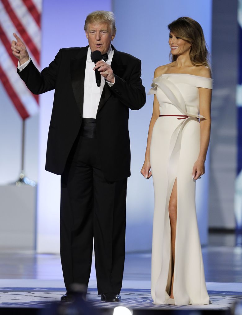 "FILE – In this Jan. 20, 2017 file photo, President Donald Trump with first lady Melania arrive at the Freedom Ball in Washington at the Washington Convention Center during the 58th presidential inauguration. Slovenian-born Melania Trump has been unafraid to go against her husband's ""America First"" agenda, and stay true to her roots, if there's a message to be taken from her bold, foreign-flavored first lady wardrobe in 2017.   (AP Photo/Mark Tenally)"