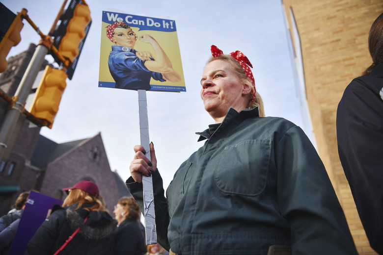 """Sioux Falls, South Dakota: Sheila Dathe wears a """"Rosie the Riveter"""" inspired work uniform to the Women's March Saturday in downtown   Sioux Falls, S.D.  (Briana Sanchez /The Argus Leader)"""