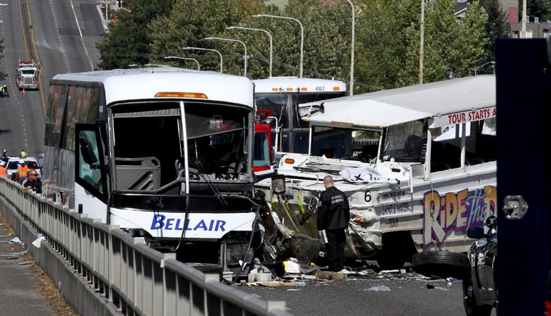 Investigators at the scene of the fatal crash on the Aurora Bridge between a bus and a Ride the Ducks vehicle in September  2015.  (Alan Berner / The Seattle Times)