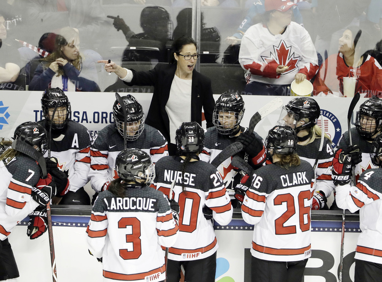 FILE – In this Dec. 15, 2017, file photo, Canada head coach Laura Schuler, top center, instructs her team during the third period of a women's hockey game against the United States in San Jose, Calif. Schuler is the first former player to coach the Canadian women, and she is on a one-year break from her job coaching Dartmouth trying to extend Canada's hold on Olympic gold to five straight at the 2018 Winter Games. (AP Photo/Marcio Jose Sanchez, File)