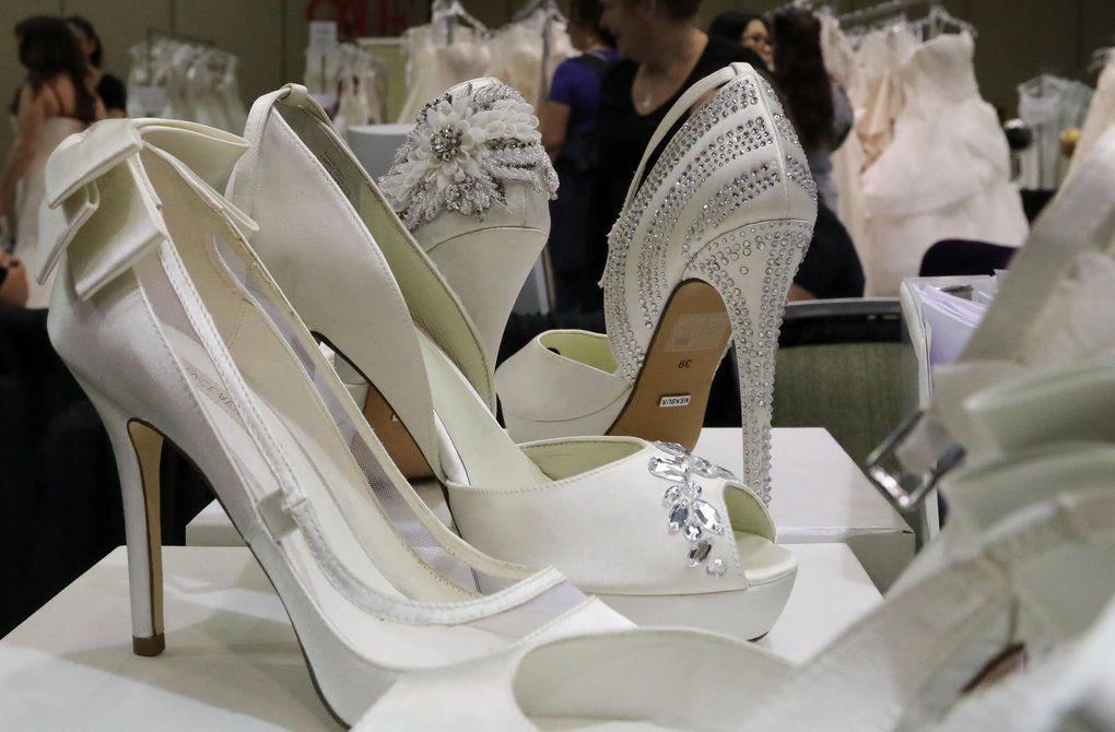 Elevate the wedding with high heels, providing another 4 inches in height.  (Alan Berner/The Seattle Times)