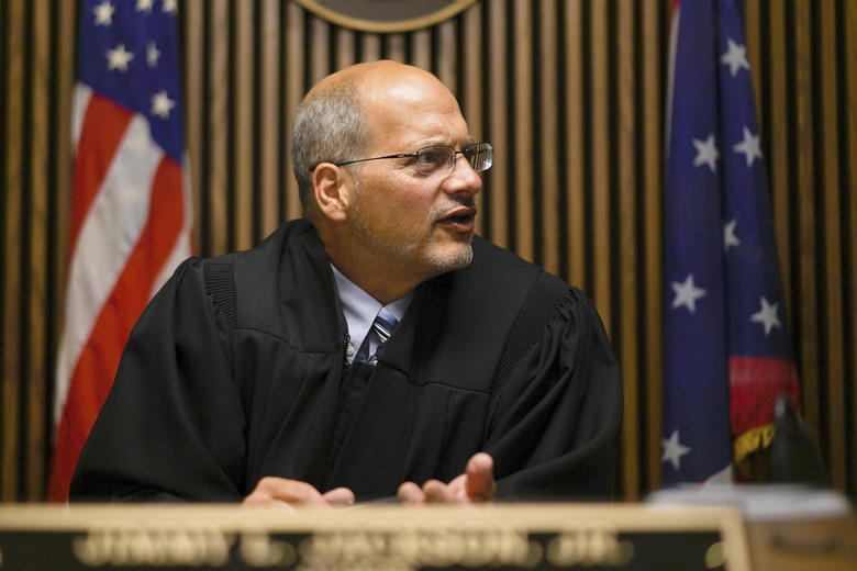 In this Aug. 30, 2017, photo, Judge Jimmy Jackson Jr. speaks on the first day of the use of risk-assessment software in Municipal Court in Cleveland. His court is joining other courts across the country in use of artificial intelligence to help determine bond and parole for defendants. (AP Photo/Dake Kang)