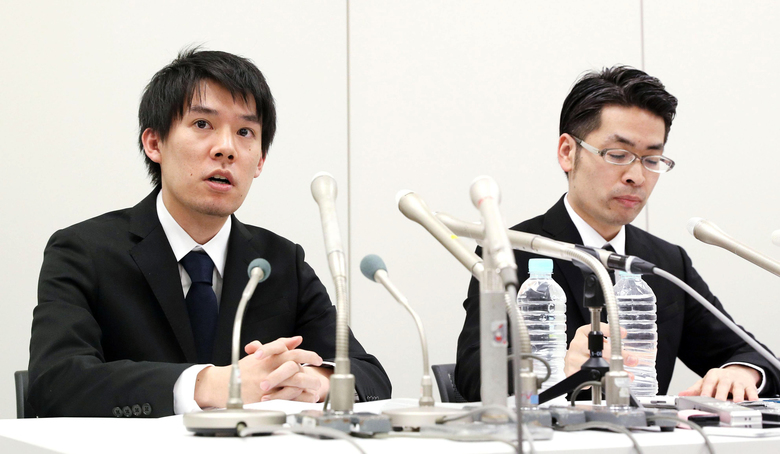 In this Friday, Jan. 26, 2018, photo, Coincheck President Koichiro Wada, left, answers a reporter's question during a news conference in Tokyo. Japanese media say the Coincheck exchange has lost 58 billion yen ($530 million) in cryptocurrency because of hacking.  (Takuya Inaba/Kyodo News via AP)