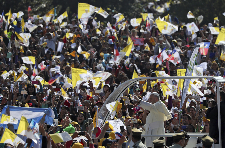 "Pope Francis arrives on his pope-mobile to celebrate Mass at O'Higgins Park in Santiago, Chile, Tuesday, Jan. 16, 2018. Francis begged for forgiveness Tuesday for the ""irreparable damage"" done to children who were raped and molested by priests, opening his visit to Chile by diving head-first into a scandal that has greatly hurt the Catholic Church's credibility here and cast a cloud over his visit. (AP Photo/Alessandra Tarantino)"