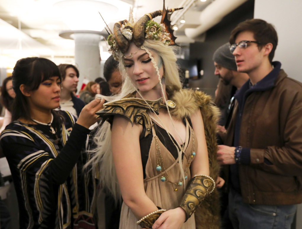 In the Capricorn costume she made, reflecting her birth sign, Sophie Hamilton is helped with her wig by Jessica Vergel as they wait for the portfolio reviews to begin at Cornish College of the Arts on National Portfolio Review Day. (Alan Berner/The Seattle Times)