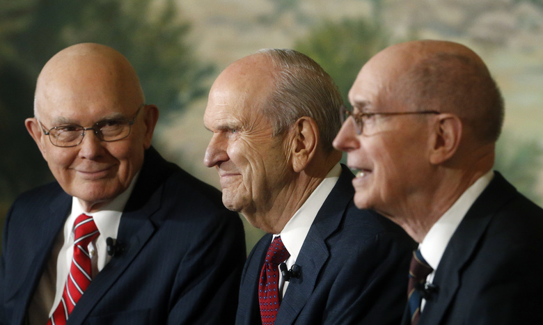 President Russell M. Nelson, center, as his counselors Dallin H. Oaks, left and Henry B. Eyring, speak during a news conference announcing his new leadership in the wake of the death of President Thomas S. Monson Tuesday, Jan. 16, 2018, in Salt Lake City. (AP Photo/Rick Bowmer)