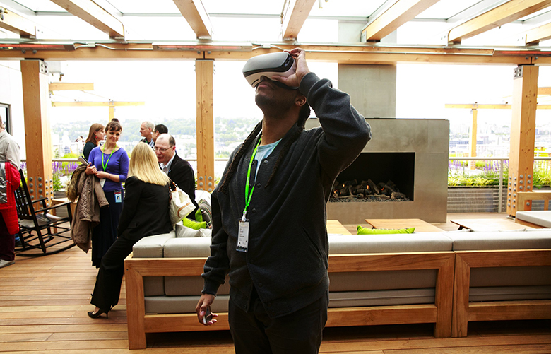David Harris, with the City of Seattle, tries on a virtual reality headset during a tour of Facebook's new offices Monday, May 16, 2016. The company gave a tour of their new building in South Lake Union, designed by architect Frank Gehry. Around 1,000 Facebook employees now work in the Seattle-area.