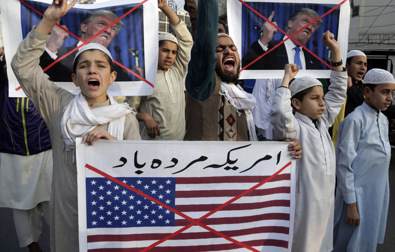 "Pakistani religious students protest against U.S. President Donald Trump holding a representation of US flag reads "" Down with America"", in Lahore, Pakistan, Friday, Jan 5, 2018. A senior Pakistani senator has expressed disappointment at the U.S. decision to suspend military aid to Islamabad, saying it will be detrimental to Pakistani-U.S. relations. Nuzhat Sadiq, the chairwoman of the Senate Foreign Affairs committee in the upper house of parliament, says Islamabad can manage without the United States as it did in the 1990s, but would prefer to move the troubled relationship forward.(AP Photo/K.M. Chaudary)"