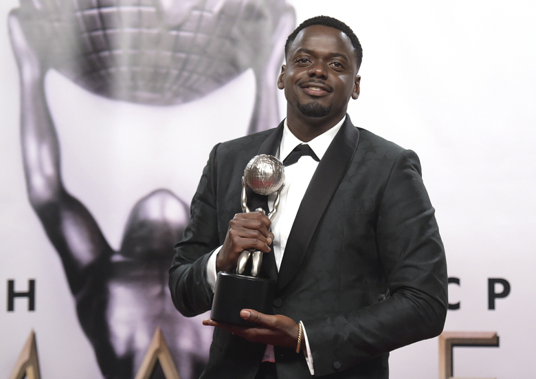 "Daniel Kaluuya poses in the press room with the award for outstanding actor in a motion picture for ""Get Out"" at the 49th annual NAACP Image Awards at the Pasadena Civic Auditorium on Monday, Jan. 15, 2018, in Pasadena, Calif. (Photo by Richard Shotwell/Invision/AP)"
