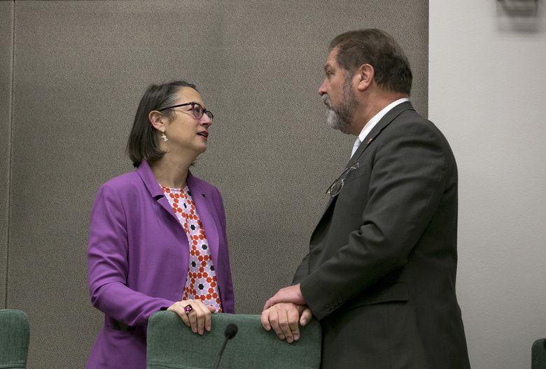 Assemblywoman Laura Friedman, D-Glendale, left, chairwoman of a joint legislative committee on sexual harassment prevention and response, talks with committee member state Sen. John Moorlach, R-Costa Mesa, before the committee hearing Wednesday, Jan. 24, 2018, in Sacramento, Calif. Lawmakers from both houses joined together to start the process to reform the Legislature's policies for handling sexual harassment allegations. (AP Photo/Rich Pedroncelli)