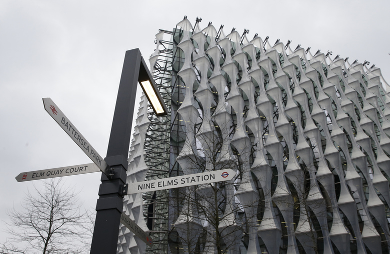 A general view of the new United States Embassy building, with signs for the local railway stations outside, in London, Friday, Jan. 12, 2018. President Donald Trump says he canceled upcoming trip to London because he doesn't like the choice of a new embassy. Some British lawmakers have questioned whether Trump would be welcome in London after some of his earlier comments. (Alastair Grant/AP)