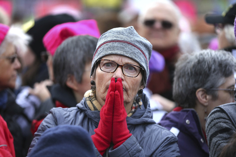 Cambridge, Mass.: Kathy Beebie listens to a speaker during a women's march and rally held on the Cambridge Common in Cambridge, Mass., Saturday.  (John Tlumacki/The Boston Globe)