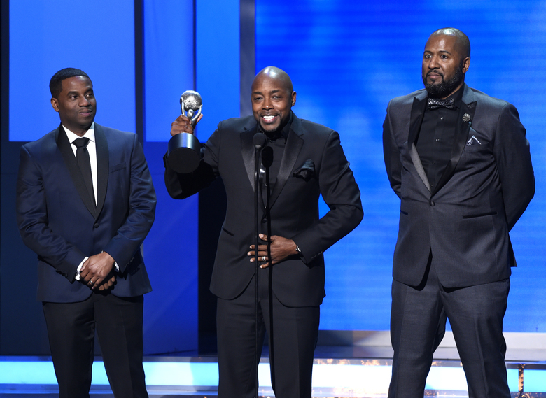 "James Lopez, from left, Will Packer, and Malcolm D. Lee accept the award for outstanding motion picture for ""Girl's Trip"" at the 49th annual NAACP Image Awards at the Pasadena Civic Auditorium on Monday, Jan. 15, 2018, in Pasadena, Calif. (Photo by Chris Pizzello/Invision/AP)"