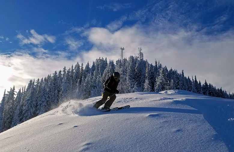 A skier turns in powder below Wardner Peak at Silver Mountain Ski Resort, Idaho. (Willy Bartlett)