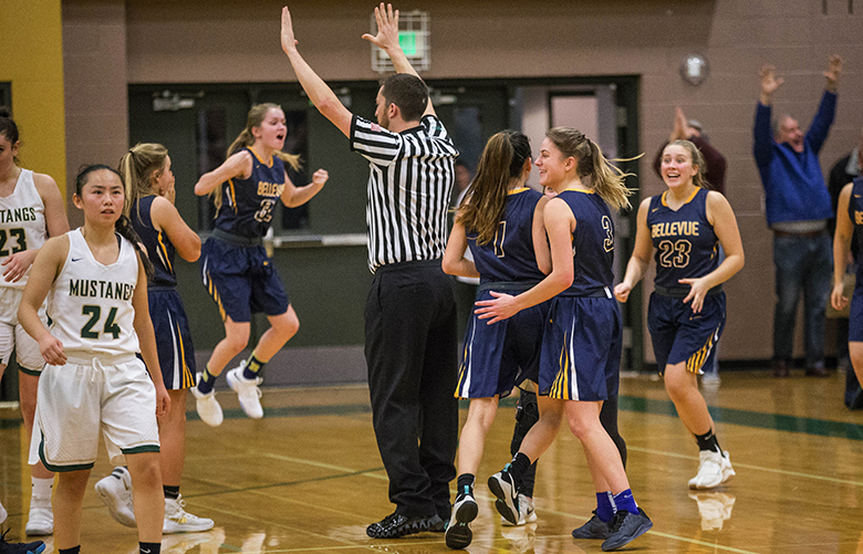 Bellevue erupts after the 3-point shot by Kara Choi (1) at the end of regulation sent the game with Redmond into overtime.  From there Bellevue would take care of business beating unbeaten Redmond 68-62.  KingCo 3A's top girls teams – Bellevue and Redmond – faced off in a game to determine the league's front-runner Friday, January 19, 2017 at Redmond High School.