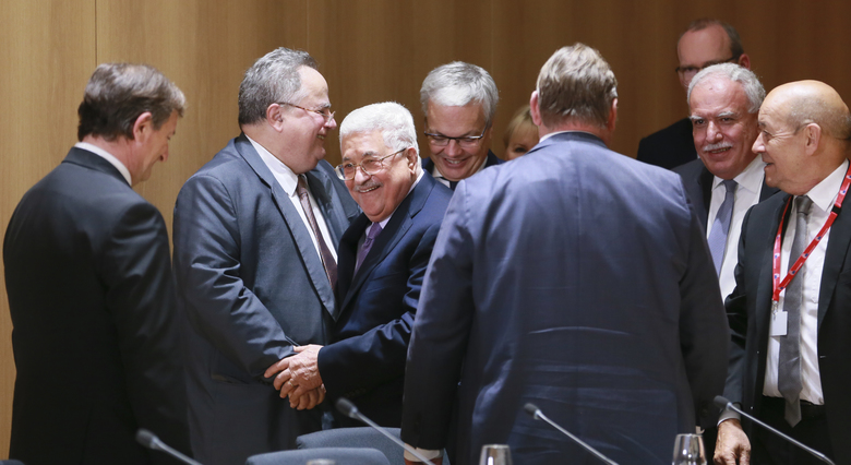 Palestinian President Mahmoud Abbas, 3rd left, arrives for a lunch with EU foreign ministers at the EU Council in Brussels on Monday, Jan. 22, 2018. French Foreign Minister Jean-Yves Le Drian said Monday that France wants the European Union to start work on an agreement on closer ties with the Palestinian territories. (AP Photo/Olivier Hoslet, pool)
