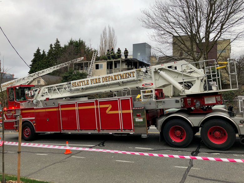 Seattle firefighters on Thursday at a house fire at 15th Avenue and East  Cherry Street, where a  ladder truck came in contact with live power lines. No injuries were reported. (Seattle Fire Department)