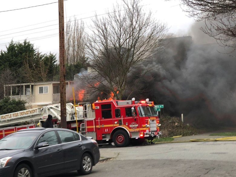 Seattle firefighters on Thursday extinguish a fire in a single-family home at 15th Avenue and East  Cherry Street. No injuries were reported. (Seattle Fire Department)