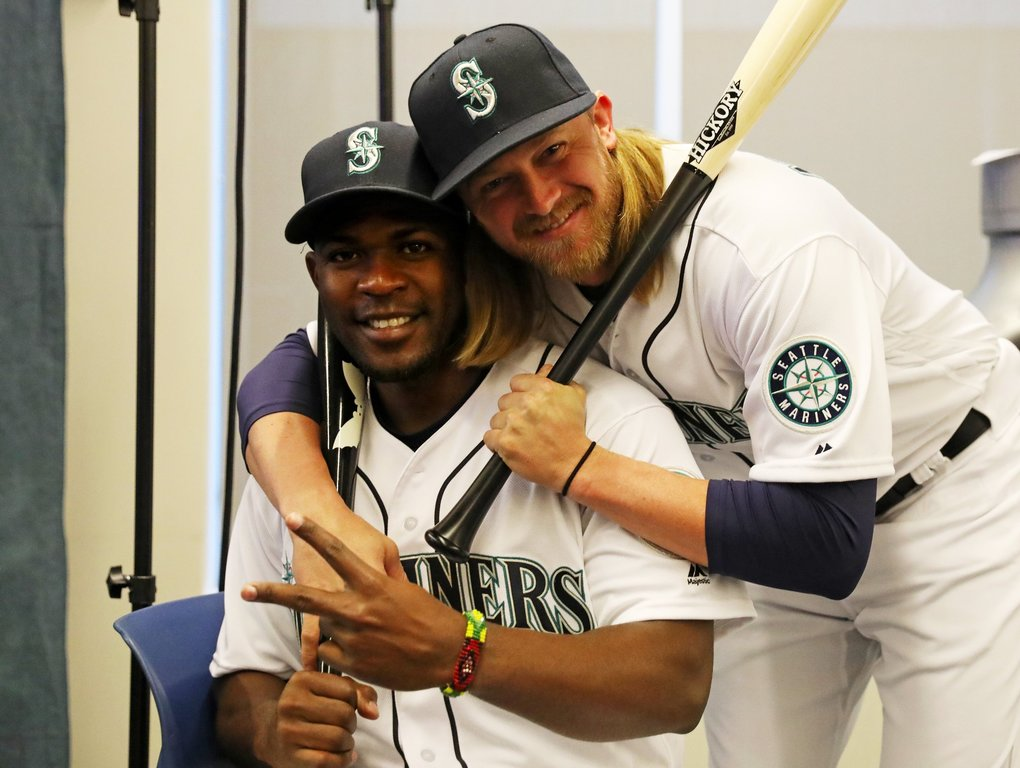 While waiting between official photography stations, outfielder Guillermo Heredia, left, and infielder Taylor Motter, right, spontaneously strike a pose during Mariners photo day. (Ken Lambert / The Seattle Times)