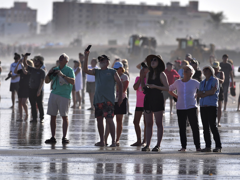 Crowds of people, reminiscent of shuttle launch days, line the beaches of Cape Canaveral and Cocoa Beach Tuesday, Feb. 6, 2018,  to watch the launch of the SpaceX Falcon Heavy from Pad 39A at Kennedy Space Center and the return of the rocket's boosters landing at Landing Zone 1 and 2 at Cape Canaveral Air Force Station. (Malcolm Denemark/Florida Today via AP)