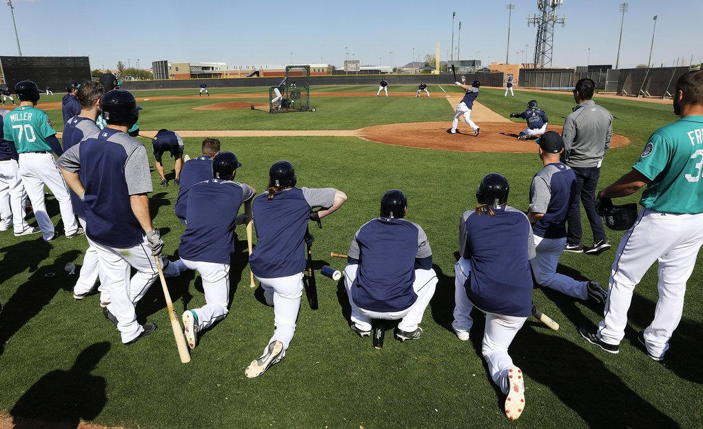 Mariners split into two teams to play a situational game exercise at spring training, Thursday, Feb. 22, 2018, in Peoria, Ariz.  (Ken Lambert / The Seattle Times)