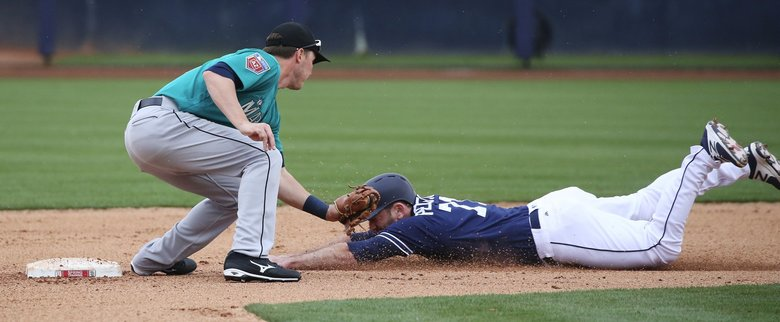 Zach Vincej of the Mariners tags out Shane Peterson of the Padres in the seventh inning during the Cactus League opener, Friday, Feb. 23, 2018, in Peoria, Ariz. (Ken Lambert / The Seattle Times)