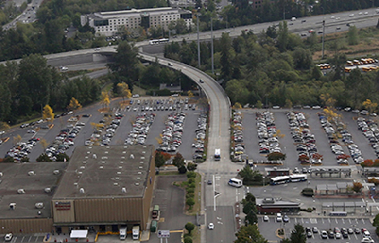 Aerial shot of Lynnwood Transit Center in Lynnwood, WA, future site of the new Sound Transit light rail station in Lynnwood.  A garage will be built and will have surface parking for approximately 1,900 vehicles.  The station will be located to the left at the end of the big ramp at center of frame that comes off of I-5.  Shot Friday, September 16, 2016.