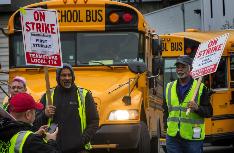 A bus driver waits as other drivers picket First Student's bus lot on Seattle's First Avenue on Wednesday, day five of the strike. At least 50 people have crossed the picket line.  (Ellen M. Banner/The Seattle Times)