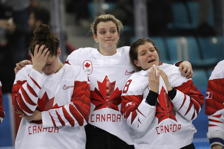 Team Canada, silver, react during the medals ceremony for women's hockey at the 2018 Winter Olympics in Gangneung, South Korea, Thursday, Feb. 22, 2018.(AP Photo/Julio Cortez)