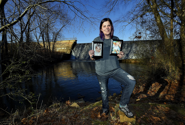 Sarah Sherbert poses for a photo in Anderson, S.C., on Monday, Feb. 5, 2018, holding photos of her children when they were infants. Sherbert, 31, said her drug use began eight years ago after she was prescribed opioid painkillers for injuries from a car accident. She was on methadone prescribed by her doctor when her daughter, now 3, was born. (AP Photo/Richard Shiro)