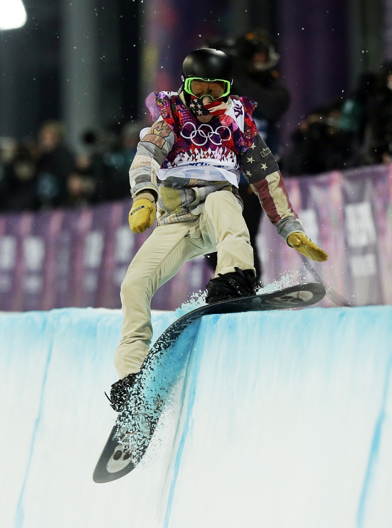 FILE – In this Feb. 11, 2014, file photo, Shaun White, of the United States, hits the edge of the halfpipe during the men's snowboard halfpipe final at the Rosa Khutor Extreme Park, at the 2014 Winter Olympics in Krasnaya Polyana, Russia. White says there were times in the weeks after he slammed his face into a halfpipe in New Zealand and had to be helicoptered off the mountain when he wondered what was to be learned from it all. To outsiders, the answer is simple. The accident served as a jarring reminder of the hurdles White was willing to overcome to make it back to the Olympics, and this time, to leave with a third gold medal. (AP Photo/Andy Wong, File)