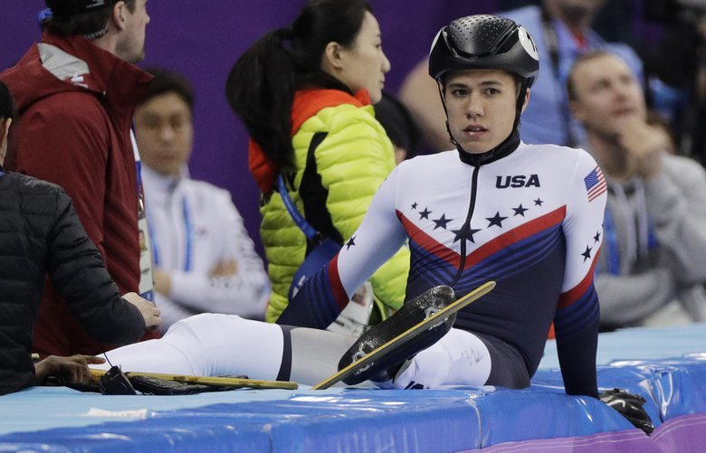 J.R. Celski of the United States sits on the pads after a crash during his men's 1000 meters short track speedskating heat in the Gangneung Ice Arena at the 2018 Winter Olympics in Gangneung, South Korea, Tuesday, Feb. 13, 2018. (AP Photo/David J. Phillip) OLYFS155 OLYFS155