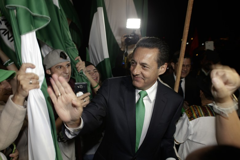 Presidential candidate Antonio Alvarez with the National Liberation party greets supporters after he attended a live, televised debate in San Jose, Costa Rica, Thursday, Feb. 1, 2018. Alvarez, a 59-year-old agricultural businessman, two-time president of the Legislative Assembly and former Cabinet minister under the first presidency of Oscar Arias in 1986-1990, is running on promises to create 150,000 jobs, decrease the deficit and modernize public transportation (AP Photo/Arnulfo Franco)