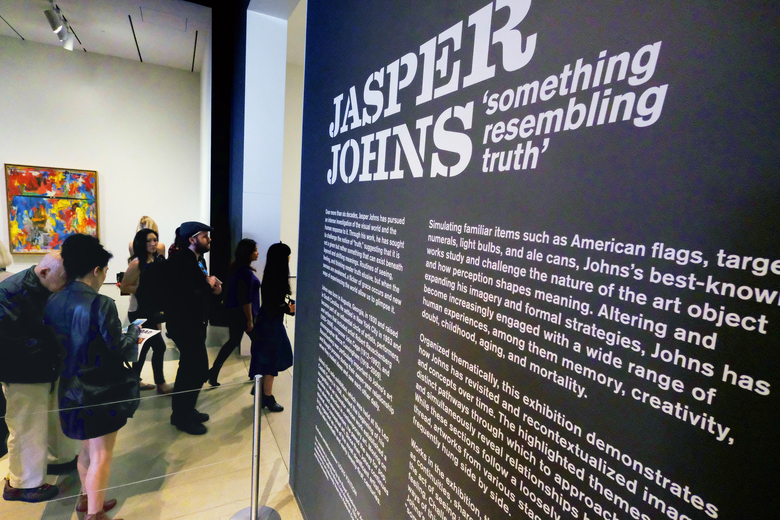 This Wednesday, Feb. 7, 2018 photo journalists arrive for a media preview of an exhibition by artist Jasper Johns at The Broad in Los Angeles. Jasper Johns 'Something Resembling Truth' is the first major survey of the artist's work to be shown in Los Angeles and will be on view at The Broad Feb. 10, 2018 through May 13, 2018. (AP Photo/Richard Vogel)