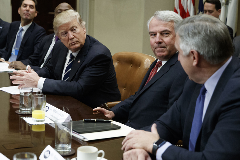 FILE – In this Jan. 31, 2017, file photo, President Donald Trump listens during a meeting with pharmaceutical executives including Celgene Corp.'s Executive Chairman Bob Hugin, second from right, in the Roosevelt Room of the White House in Washington. Hugin, who retired from the pharmaceutical firm on Monday, Feb. 5, 2018, announced in a Monday, Feb. 12, 2018, email he will challenge the re-election bid of U.S. Sen. Bob Menendez, D-N.J., by competing for the Republican nomination in New Jersey's Tuesday, June 5, 2018, primary against technology consultant Richard Pezzullo. (AP Photo/Evan Vucci, File)