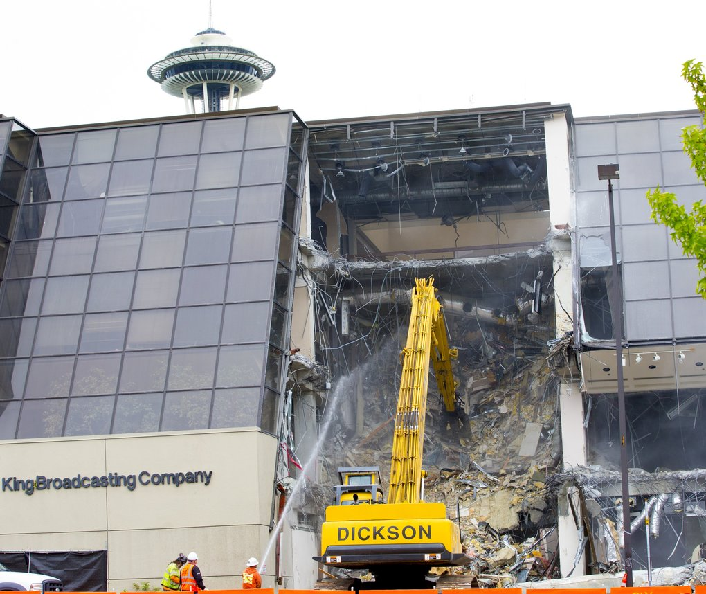 A longtime community-focused news outlet under its former ownership of the Bullitt Family, KING 5, now owned by media conglomerate Tegna, experienced a dramatic corporate makeover during the past decade of tumultuous change in Seattle-area media. A visible manifestation was destruction of its longtime South Lake Union headquarters in July 2016. (Mike Siegel/The Seattle Times)
