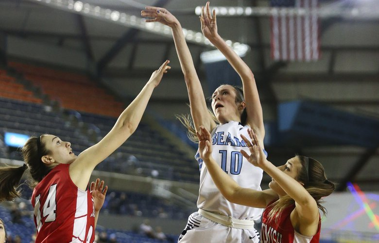 Central Valley's Lexie Hull shoots against Snohomish post Ellie Flitsch, left and Snohomish guard Shaylee Harwood during the second half in the 4A Girls title game during the Hardwood Classic tournament at the Tacoma Dome on Saturday, March 5, 2016. Central Valley beat Snohomish to take the state title, 57-48.
