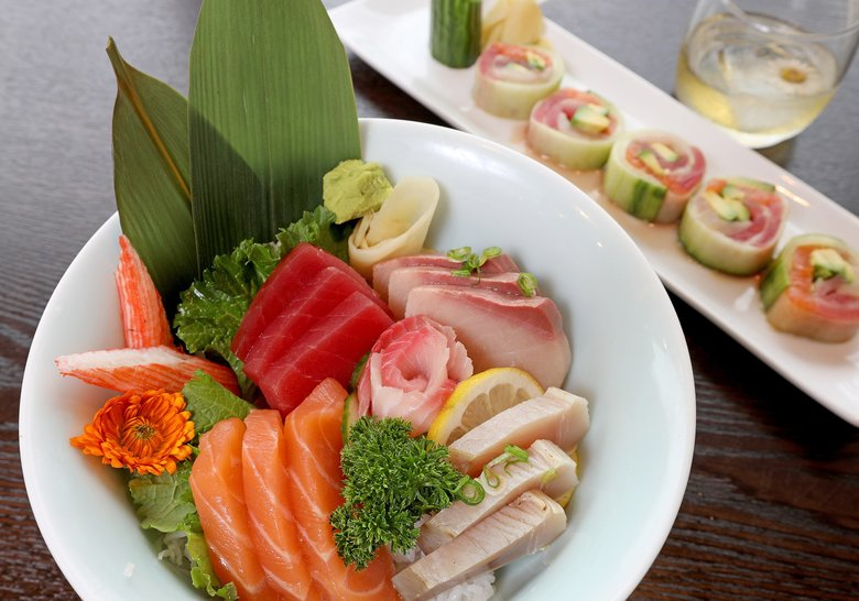 Orenji Sushi & Noodles offers, from left, a chirashi bowl filled with sashimi, Jade Roll and Hibiki Suntory Whisky on the rocks. (Greg Gilbert/The Seattle Times)