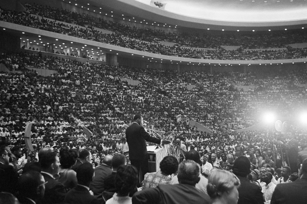King speaks to an overflow crowd in Detroit's Cobo Hall Arena on June 24, 1963, after a Freedom March. An estimated 100,000 walkers paraded to the hall through downtown Detroit and gathered in the hall and overflowed outside to hear him speak on the rights of blacks. (The Associated Press)