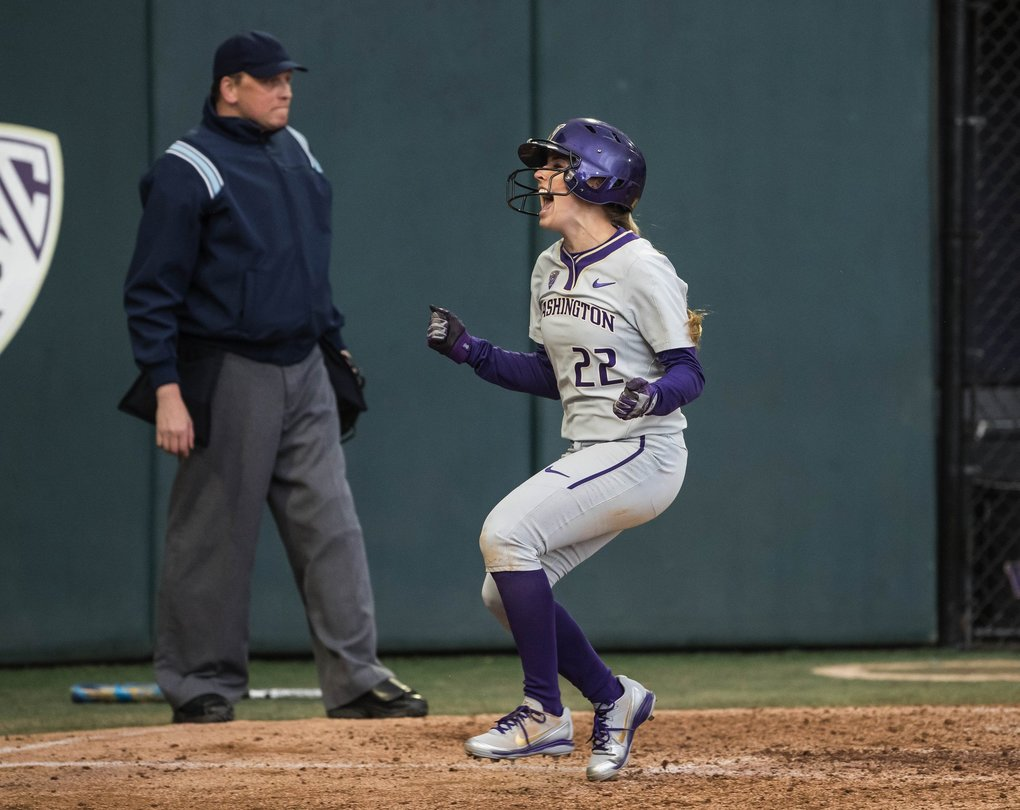 Washington's Sis Bates celebrates scoring on the Kirstyn Thomas 2-run single in the 2nd inning against Alabama.  (Dean Rutz / The Seattle Times)
