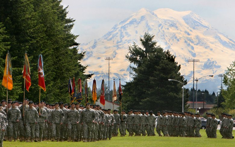 With Mount Rainier looming in the background, multiple formations of I-Corps soldiers pass the review stand during a change-of-command ceremony in 2010.  (Steve Bloom / The Olympian via AP)