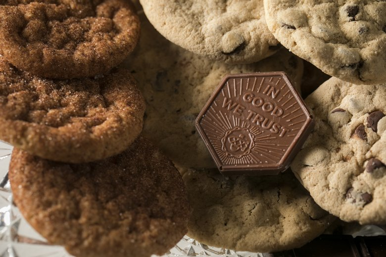 The Goodship specializes in making cannabis-infused sweet treats, like these cookies and chocolate tokens.  (Bettina Hansen/The Seattle Times)