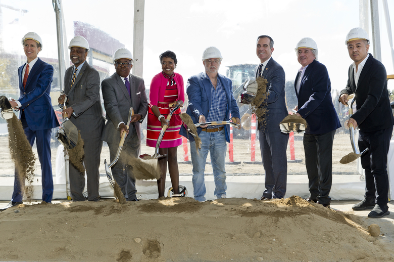 """Left to right: Lucas Museum of Narrative Art Founding President, Don Bacigalupi, Los Angeles City Councilmember Curren Price, County Supervisor Mark Ridley-Thomas, Co-Founders, Mellody Hobson, and filmmaker George Lucas, Los Angeles Mayor Eric Garcetti, Angelo Garcia, and architect Ma Yansong break ground the Lucas Museum of Narrative Art in Los Angeles Wednesday, March 14, 2018. The institution, scheduled to open in 2021, is envisioned as not just a repository for """"Star Wars"""" memorabilia but a wide-ranging museum representing all forms of visual storytelling from paintings and drawings to comic strips and digital and traditional films. (AP Photo/Damian Dovarganes)"""