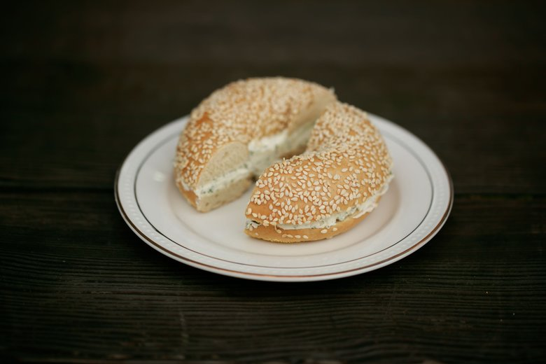 A sesame bagel with dill schmear at Westman's Bagel and Coffee on Capitol Hill. (Erika Schultz/The Seattle Times)