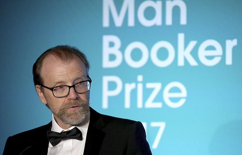 Man Booker prize winner George Saunders of the U.S. speaks at the Guildhall in London, during the 2017 Man Booker award ceremony, Tuesday, Oct. 17, 2017. (Chris Jackson/PA via AP)