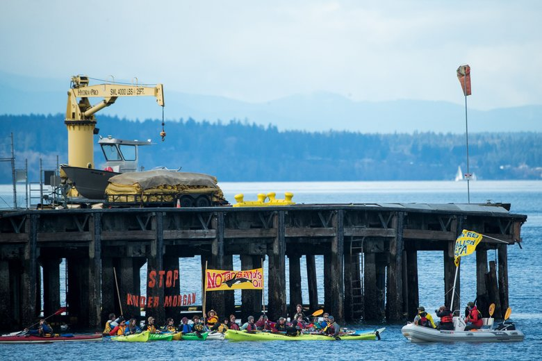Kayakers protest Kinder Morgan's Trans Mountain pipeline project Sunday on the Duwamish Waterway.  (Courtney Pedroza/The Seattle Times)