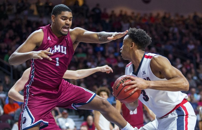 Loyola Marymount's Zafir Williams (1) defends against Gonzaga's Johnathan Williams (3) during the second half of an NCAA college basketball game in the quarterfinals of the West Coast Conference men's tournament Saturday, March 3, 2018, in Las Vegas. (AP Photo/L.E. Baskow)